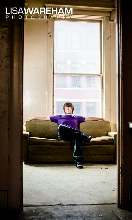 The architecture, furniture and window views add to the ambiance of senior portraits in old buildings in Uptown Butte.