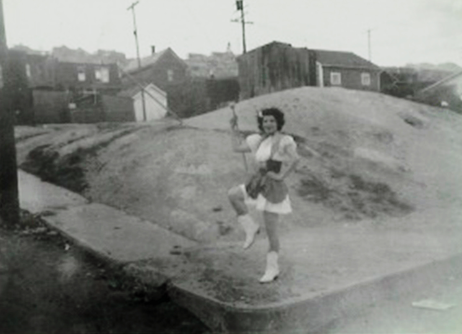 Florence in front of a mine dump on Oklahoma Street in her family neighborhood.
