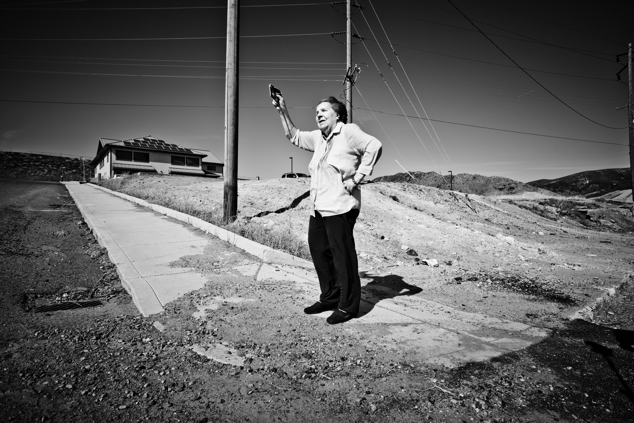 Florence in 2014 holding her Butte High School letter in front of the same mine dump on Oklahoma Street.